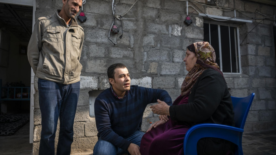 Dr. Mohammed Issa, 33, from Al-Hasakah  in northern Syria, visits a patient in Darashakran Camp, near the city of Erbil, capital of the Kurdistan Region of Iraq.