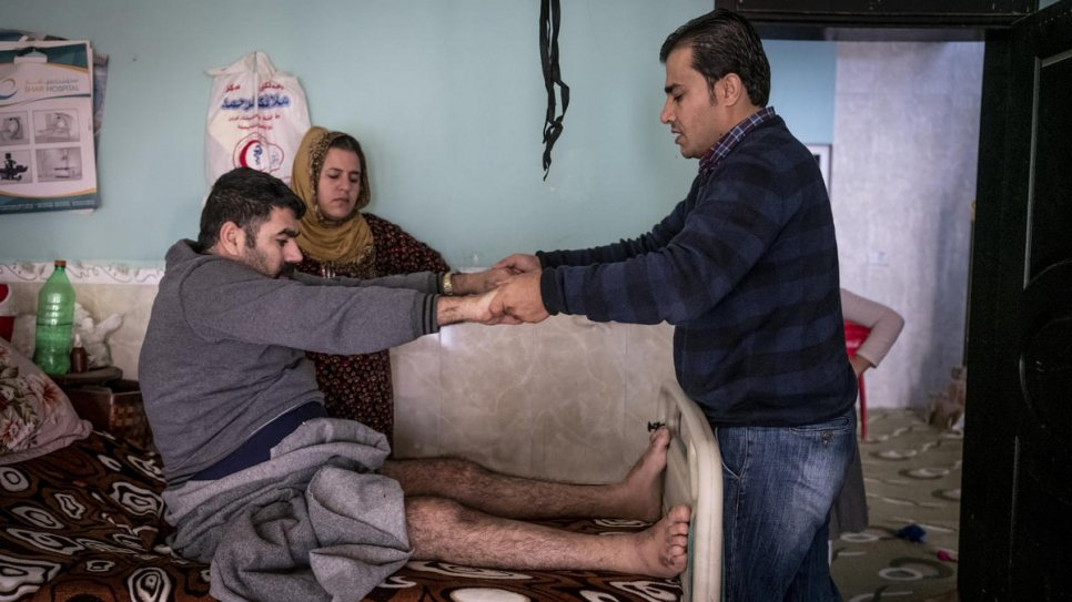 Dr. Mohammed Issa (right) visits a patient in his home in Baharka on the outskirts of Erbil, the capital of the Kurdistan Region of Iraq.