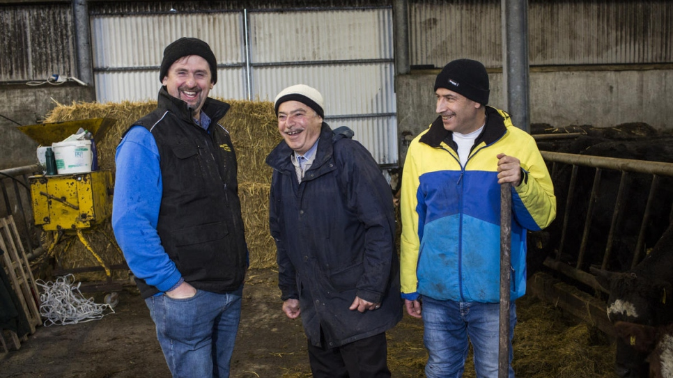 Irish farmer Oliver works with Abdulhadi, 72, and Faisal, 45, on his farm County Mayo.