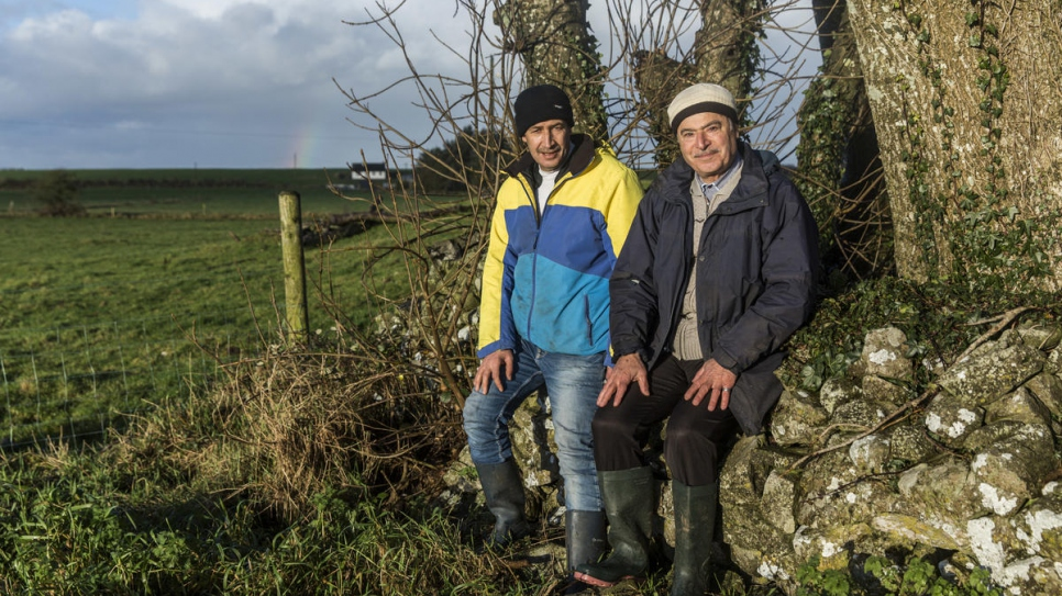 Faisal and Abdulhadi take a moment to rest on the farm in County Mayo.