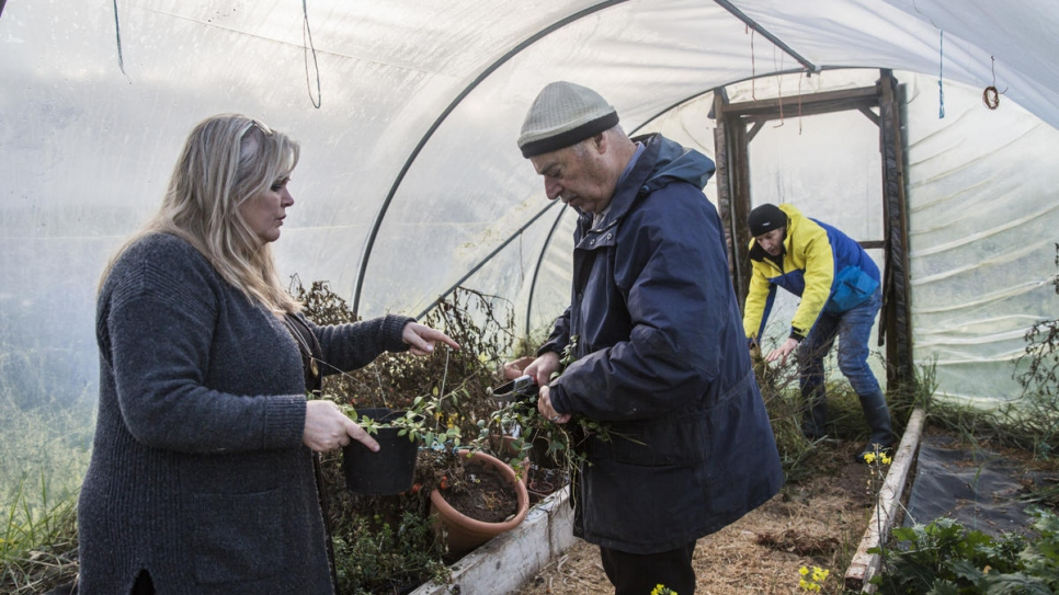 Anna, Faisal and Abdulhadi tend to the gardens and plants that grow in a polytunnel.