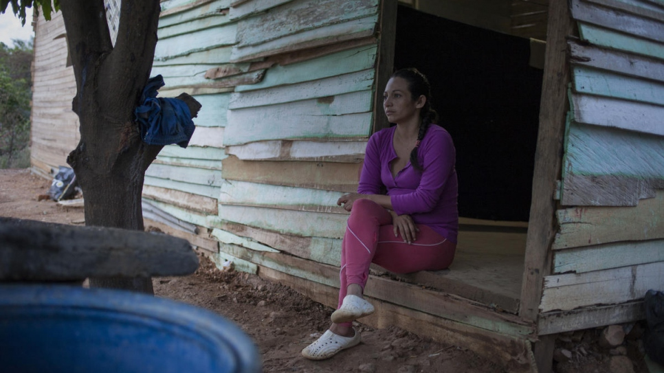 Jenire Rojas, 30, from Venezuela, sits outside Graciela Sanchez's home in Las Delicias, Cúcuta, Colombia.