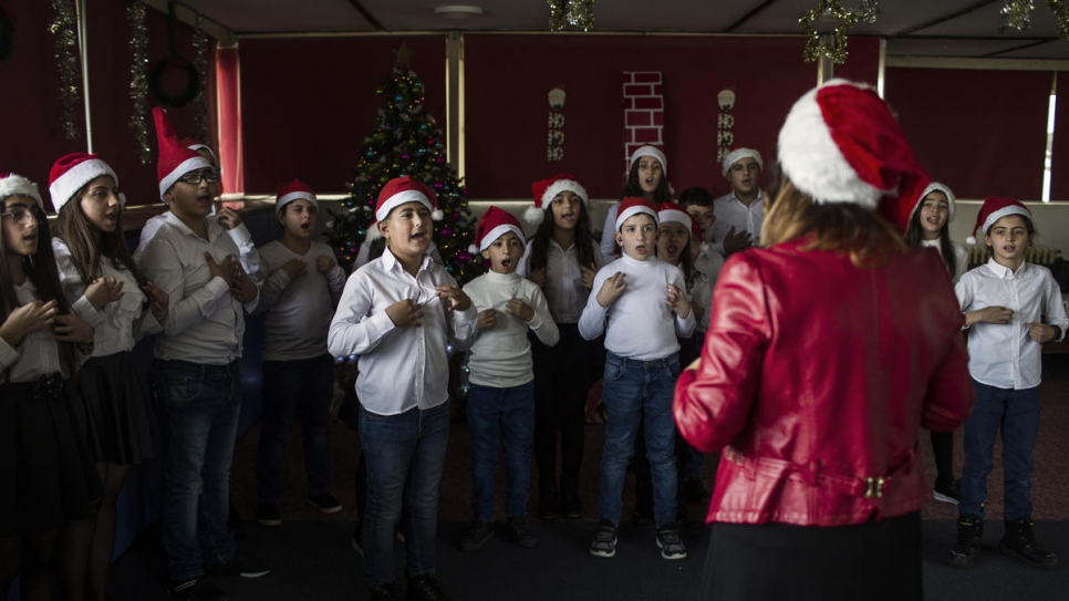 Children sing in the Christmas choir at the FAID, which welcomes Lebanese and Syrian youngsters with hearing disabilities from different religious backgrounds.