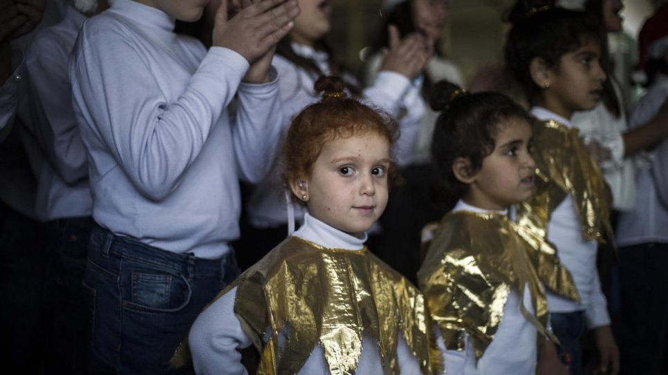Four-year-old Maysa El Kheiry escaped the war in Syria in 2016. Two years later, she enrolled in the Father Andeweg Institute for the Deaf (FAID) school where she sings in the choir.