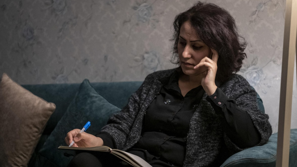 Nagham Nawzat Hasan, who was displaced from her hometown in 2014, sits at home in the city of Duhok in the Kurdistan region of northern Iraq.