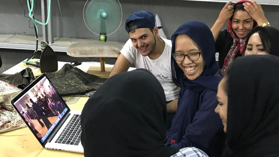 Franka Soeria (in navy blue headscarf) tutors some of the six refugees she has taken on at her Markamarie workshop in South Jakarta.