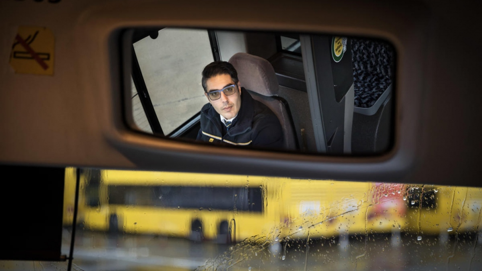 Mohamad is happy to be behind the wheel of his bus in Berlin.