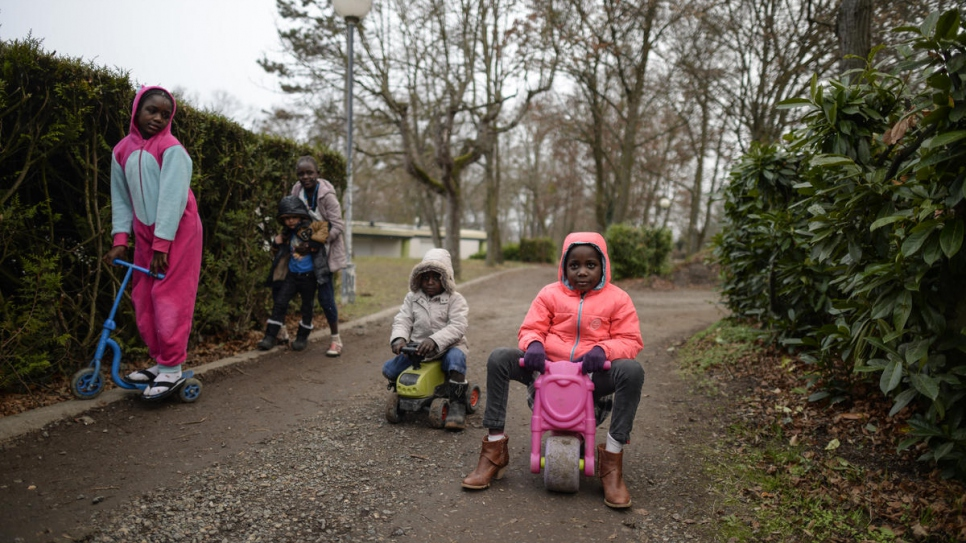 Refugee children play in the park behind Pessat-Villeneuve City Hall.