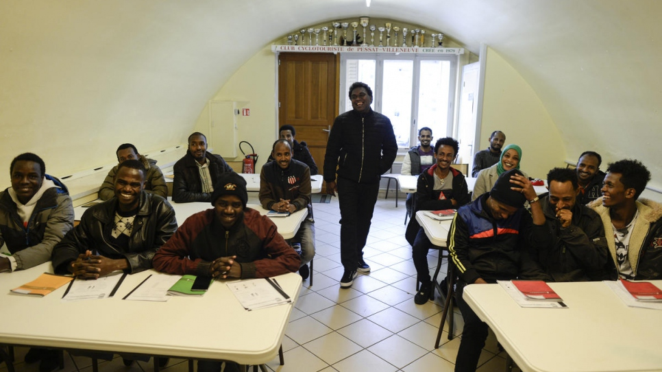 Resettled Sudanese refugee Alfatih (second on the left) attends French class.