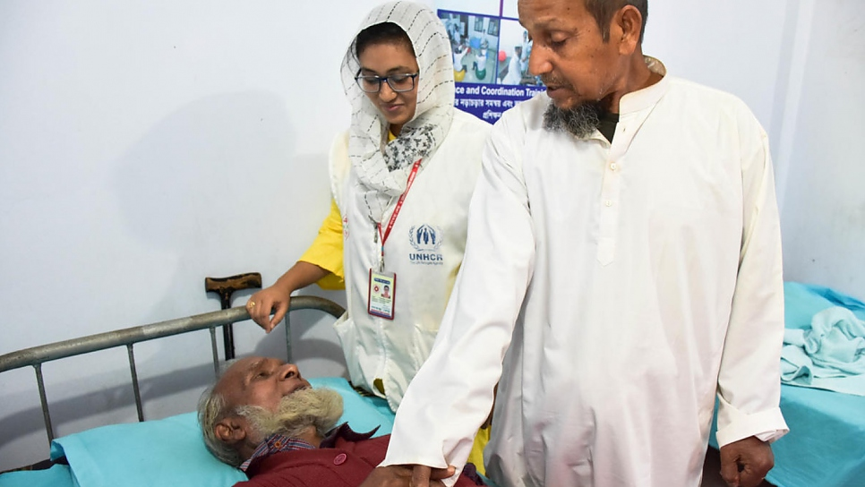 Rohingya refugee Noor Salam (in white) talks to his Bangladeshi friend Abdul Quddus at the Physiotherapy and Physical Rehabilitation Centre in Shamlapur.