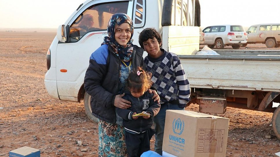 A displaced family receive vital aid delivered by a joint UN and Syrian Arab Red Crescent convoy.
