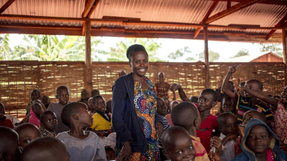 Burundian refugee Nimbona Valyne, 26, teaches at Jugudi Primary School in Nyarugusu Refugee Camp, Tanzania. There are 68 boys and 44 girls in her class.