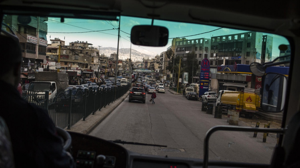 "The streets of Beirut's Dahieh neighbourhood are seen through the windshield of the ""Fun Bus""."