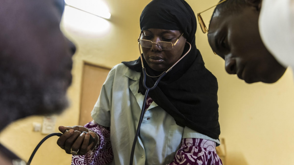 Nurse Jamilla Amadou checks a patient's vital signs at the general hospital in Gao, Mali.