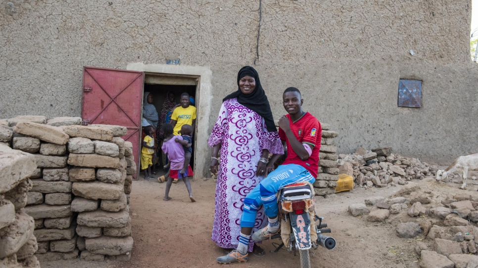 Jamilla Amadou stands outside her home in Gao with her son Omar, who wants to study computer science.