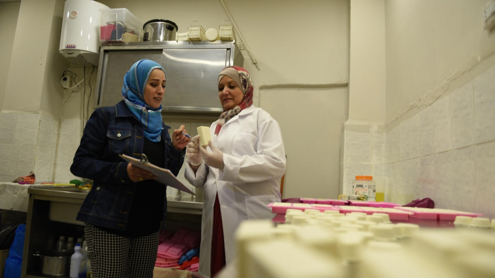 Jordanian employee Susan (left) helps Najwa to inspect the products before packaging.