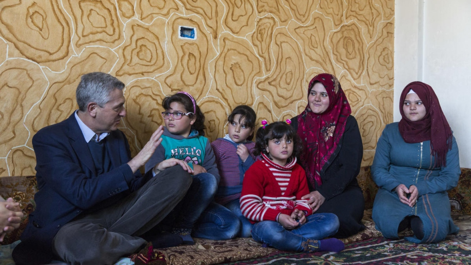 UN High Commissioner for Refugees Filippo Grandi meets Syrian returnee Zahida, 35, and her family at their home in Souran, Syria.