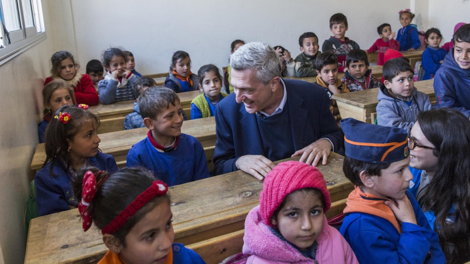 Filippo Grandi chats with pupils at the Al-Shuhada School in Souran, Syria.