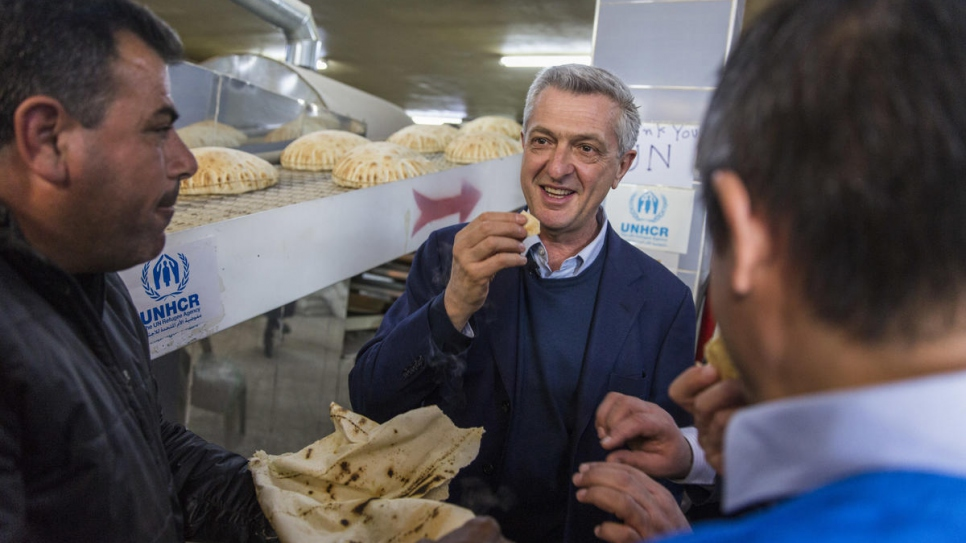 Filippo Grandi tries freshly baked bread at a bakery in Souran, Syria.