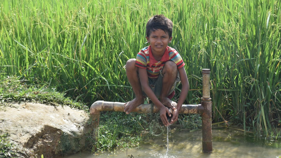 A young Rohingya boy sits on a water pipe in Chakmakul refugee settlement in southern Bangladesh.