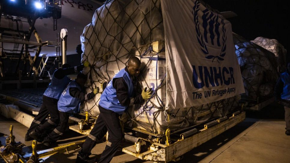 UNHCR staff unload an aircraft carrying relief items for survivors of Cyclone Idai at the airport in Maputo, Mozambique.