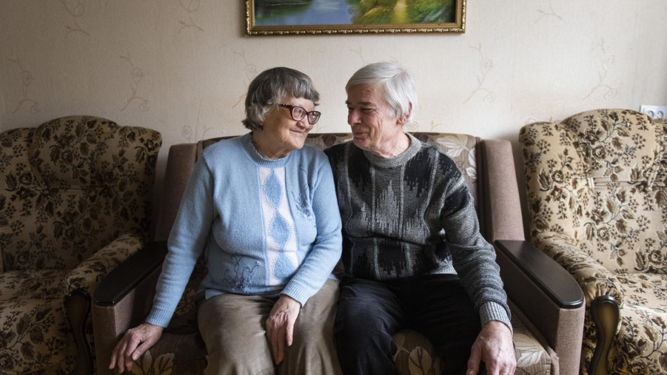 Valentyna and Volodymyr, both 71 and internally displaced, sit in their living room.