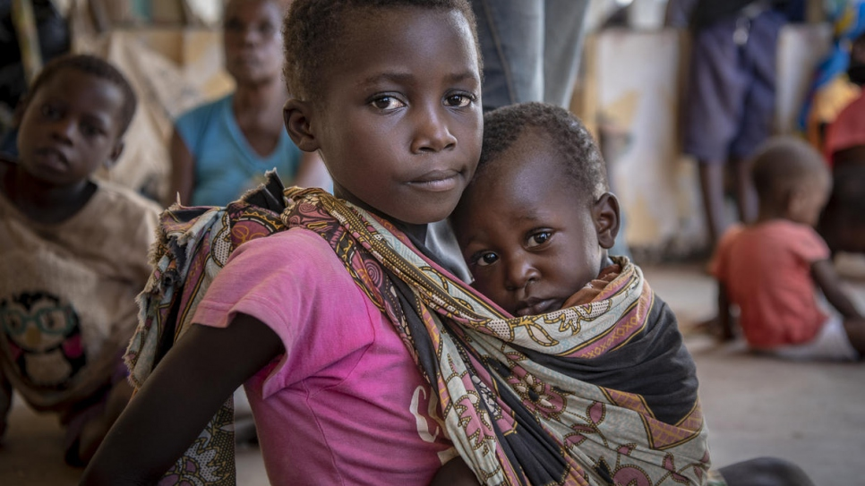 Seven-year-old Rosa holds her younger brother, Manuel, at a shelter for women and children displaced by Cyclone Idai in Buzi, Mozambique.