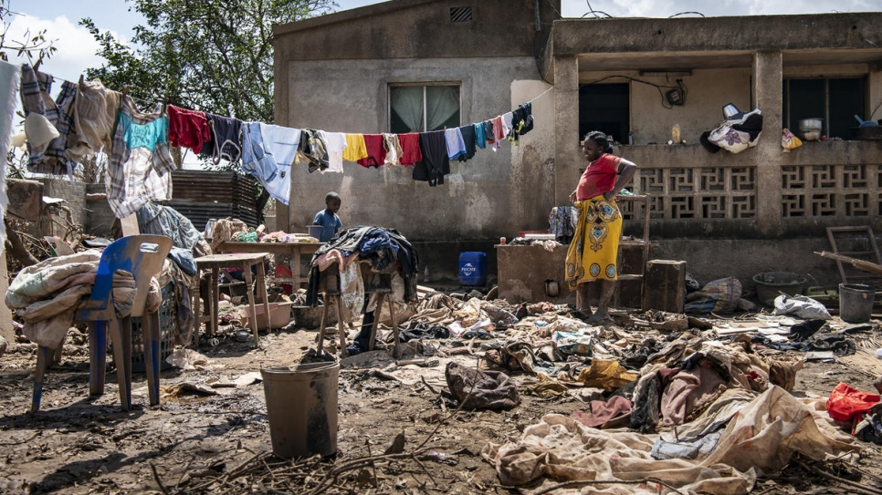 A family spreads their household belongings in the front yard to dry after Cyclone Idai's rampage through Buzi, Mozambique.