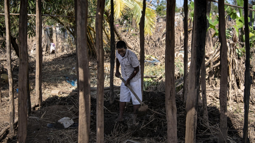 School teacher Manuel clears mud from the foundations of what was his home in Buzi, Mozambique, which was hit hard by Cyclone Idai.