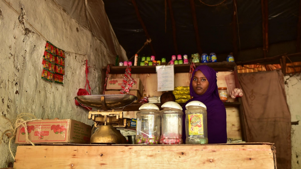 Fauzia, 23, from Ethiopia runs a grocery store in Kakuma Refugee Camp, Kenya.