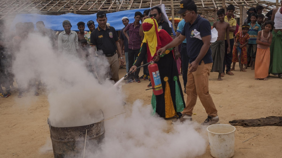 Ayesha, 25, receives fire safety training by the Bangladesh Fire Service at Kutupalong refugee camp where she has lived for seven months since her husband was killed in Myanmar.