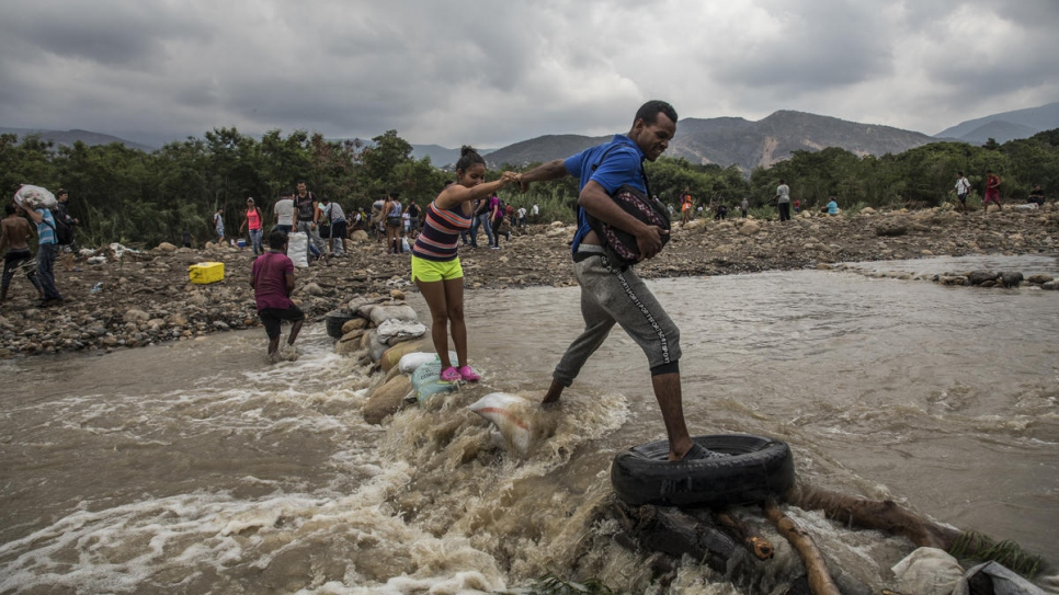 Venezuelans cross the Tachira River to seek food and safety in Cúcuta, Colombia.
