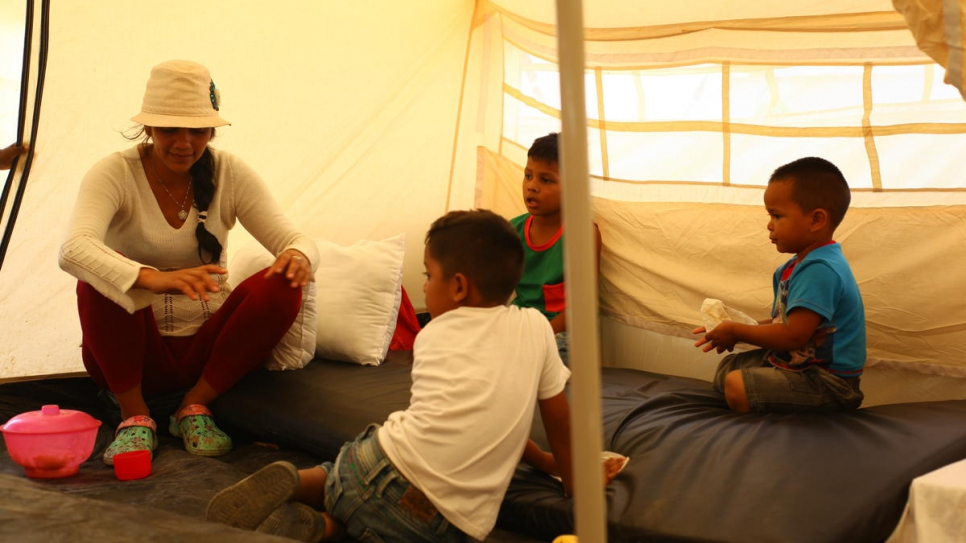 Venezuelan asylum-seeker Darlys and her children inside their tent at the newly-established Integrated Assistance Centre in Maicao, Colombia.