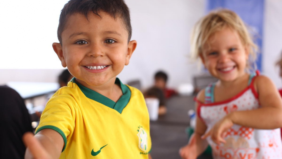 Venezuelan children arrive for meal time at the new reception centre in Maicao, Colombia.