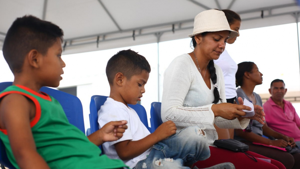 Venezuelan asylum-seeker Darlys and her children register at the new reception centre in Maicao, Colombia.