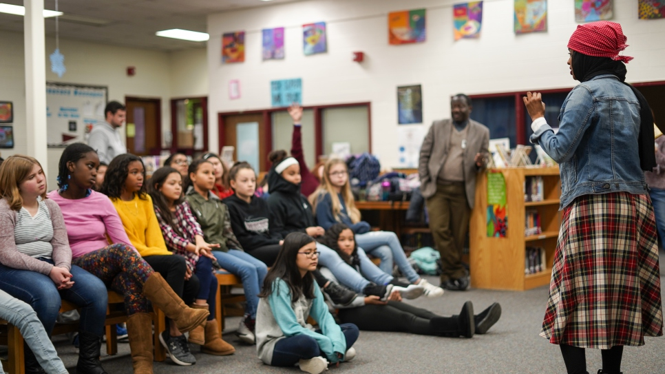 Children's book author and former Somali refugee Habso Mohamud answers questions from middle school students in Washington,D.C.