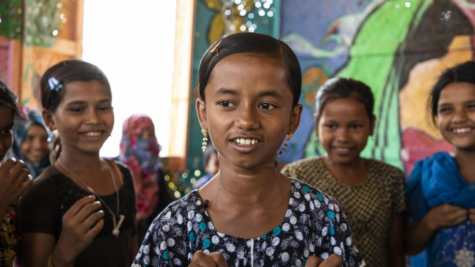 Myshara, 13, a Rohingya refugee from Myanmar, leads a group of other children who are learning to talk about their worries as part of a mental health programme at Kutupalong camp in Bangladesh.