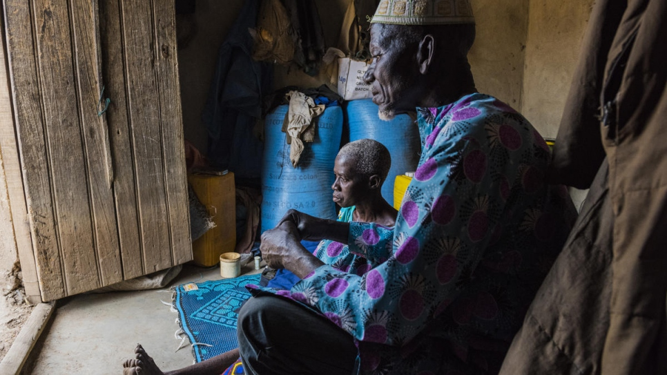Portrait of Ngolo Silué at home with his sick wife in Olleo, Côte d'Ivoire.