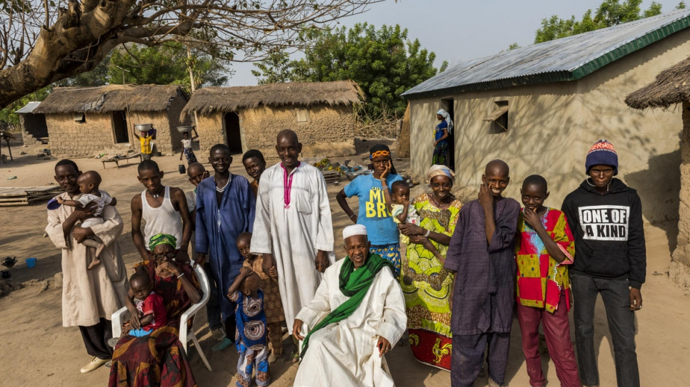 Animata Sidibé's son Seydou Tall (standing at centre in white), poses with family members outside their home in Kong, Côte d'Ivoire.