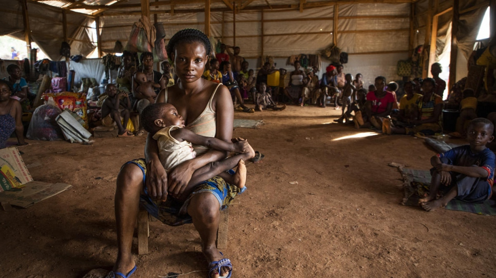 """We are safe here, but we are suffering. My child is sick. We need help.""  Jecinta Iyale, 18, from Akwaya in Cameroon, holds her child at Agadom Refugee Settlement in Ogoja, Nigeria."