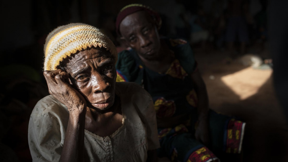 An elderly woman sits in a hall where Anglophone refugees from Cameroon wait to be relocated at the Agadom Refugee Settlement in Ogoja, Nigeria.