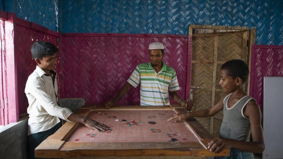 Young Rohingya refugees play carrom, a South Asian board game in Kutupalong refugee settlement, Bangladesh.