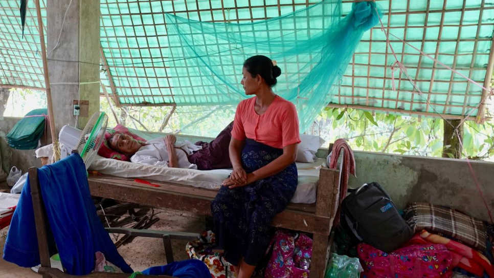 A couple await medical treatment at a Buddhist monastery in Buthidaung hosting Rakhine people recently displaced as a result of the current insecurity.