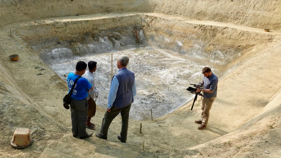 UN High Commissioner for Refugees Filippo Grandi visits a reservoir project for the local community in Maungdaw, Myanmar, which allows residents to capture rain water.