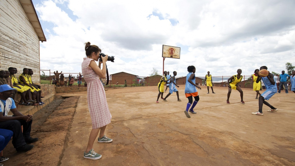 Helena captures a basketball match in Mahama refugee camp where both boys and girls are playing together.