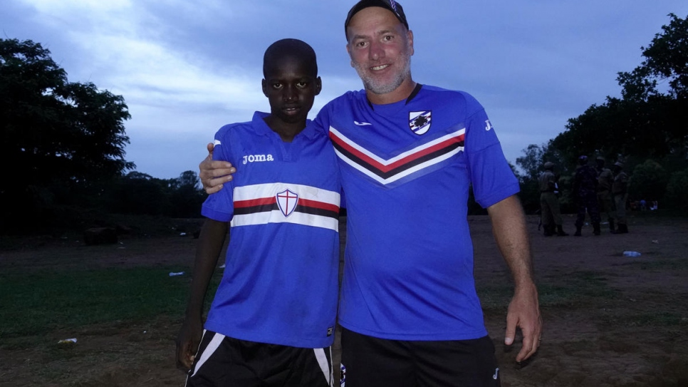 Patrick Amba, 14, with coach Marco Bracco from Sampdoria after the three-day training camp.