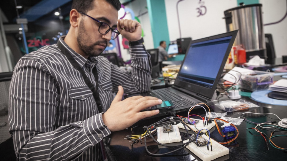 Ehab configures sensors sold by his company, Drag IOT, which measure changes in temperature and humidity.