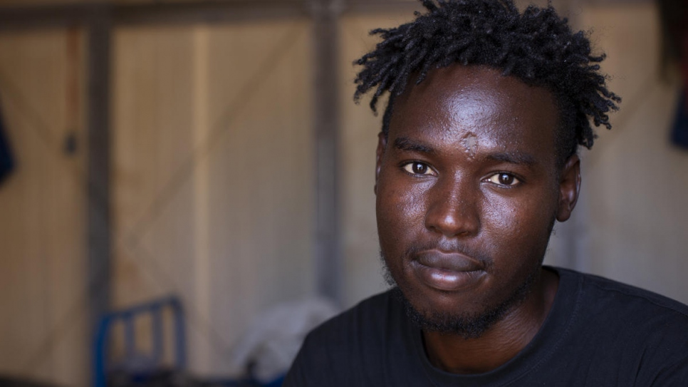 Like Maryam,* Yasir is recovering at UNHCR's Emergency Transit Mechanism camp outside of Niamey, Niger. Yasir, a Sudanese asylum-seeker, was relocated to the camp following his illegal detention in Libya, where he was shot, routinely beaten, and humiliated.