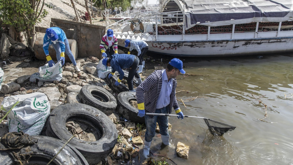 Refugee volunteers joined forces with locals to assist in the clean-up effort.
