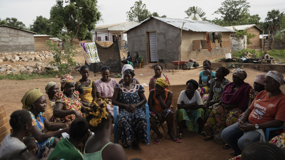 Florence Atangere (third from left), founder of the 'Standing Women' association, speaks to the members during their weekly meeting in Bangui, Central African Republic.